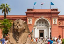 The Egyptian Museum in Cairo, one of the most famous museums of the world. Tourists come through the main entrance into the museum.