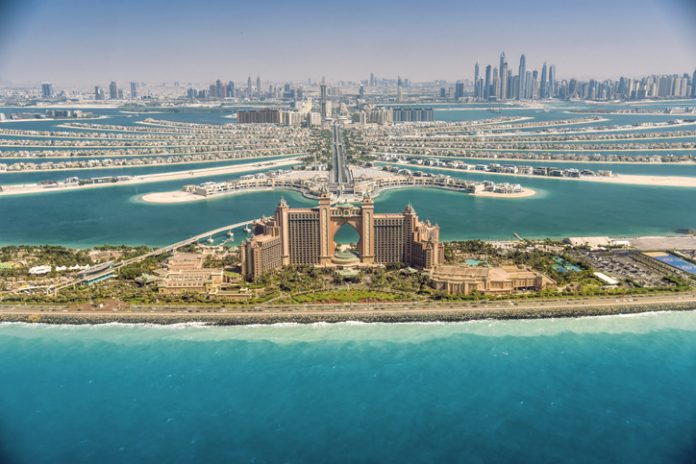 Panoramic of Dubai skyline surrounding by clear sea