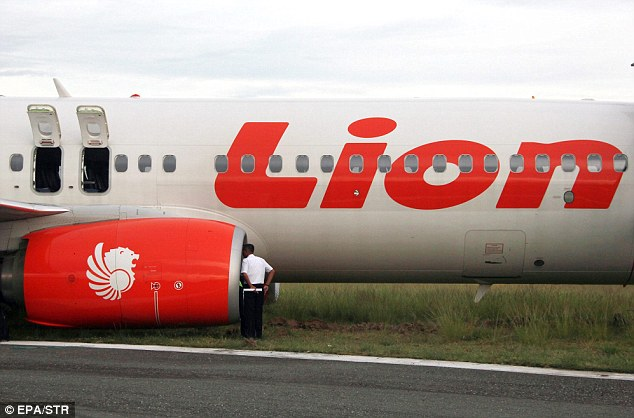 An operator checks a Lion Air plane.