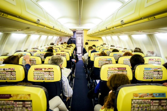 People sitting on Ryanair flight during a flight