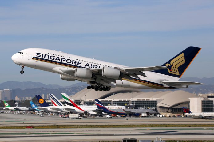 A Singapore Airlines Airbus A380 with the registration 9V-SKS taking off at Los Angeles International Airport (LAX) in the USA.
