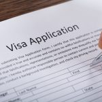 Person Filling Visa Application Form