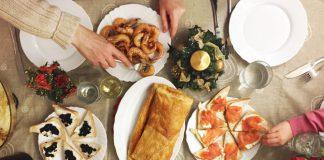 Family eating seafood, tapas and more on Christmas