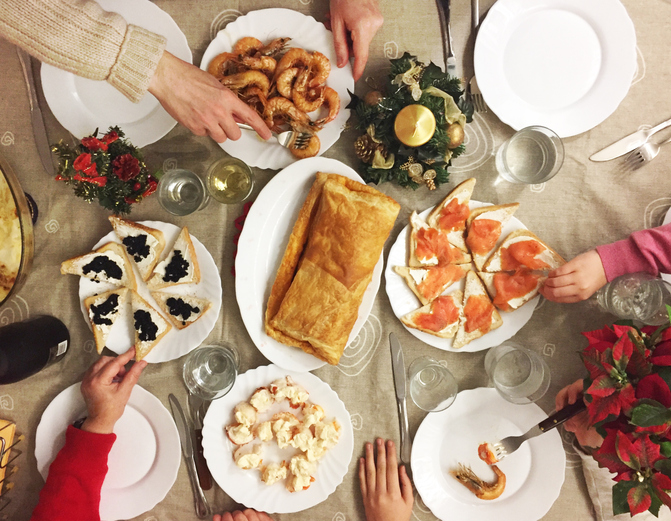 Family eating seafood, tapas and more on Christmas